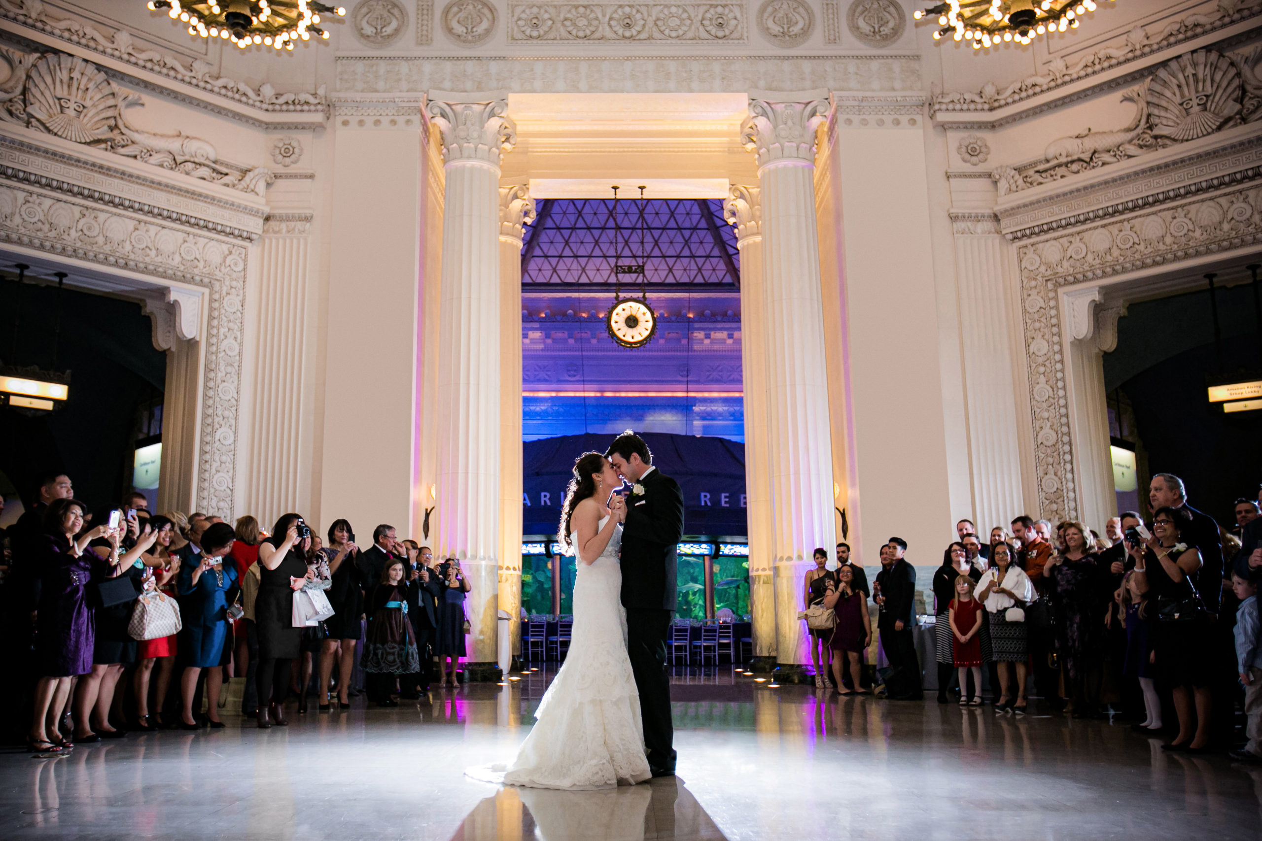 Married couple dancing at Shedd Aquarium